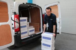 Paul loading documents into storage van
